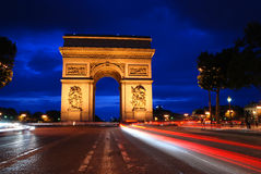 Triumph Arch at night. Beautifly lit Triumph Arch at night with light traces of passing cars. Paris, France Stock Photo