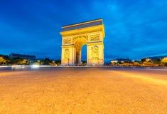 Triumph-Bogen nachts, Paris Lizenzfreie Stockfotos
