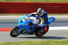 Triumph motorcycle race Stock Images