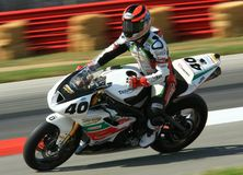 Triumph race motorcycle. Professional rider Jason DiSalvo is racing his Triumph Daytona 675 race motorcycle at the pro bike race event for the Latus Motors stock photos