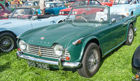 Triumph TR6. Green Triumph TR6 sports car with soft top down on show at Roseisle classic car rally held on 25th September 2016 stock images