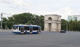 Moldova arc and bus. Triumphal arc in the park Chisinau, Moldova. Also has additional names: Sacred Gates, Arch of Victory stock image