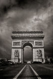 Triumphal arc. Arc the Triomphe with a grey and cloudy sky in Paris, France.  Black and white Stock Images