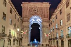 Triumphal Arch along Augusta Street - Lisbon. Augusta Street Triumphal Arch in the Commerce Square, Praca do Comercio or Terreiro do Paco at night in Lisbon Royalty Free Stock Photo