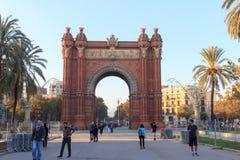 Triumphal arch Arc de Triomf and promenade Passeig de Lluis Companys in Barcelona Royalty Free Stock Photo