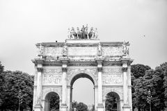 Triumphal Arch Arc de Triomphe du Carrousel. At Tuileries gardens in Paris, France. Monument was built between 1806-1808 to commemorate Napoleon`s military Royalty Free Stock Images