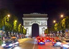 Triumphal arch Arc de Triomphe at night, Paris, France Stock Photo