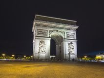 Triumphal arch Arc de Triomphe at night, Paris, France Royalty Free Stock Photos