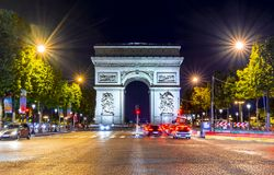 Triumphal arch Arc de Triomphe at night, Paris, France royalty free stock images