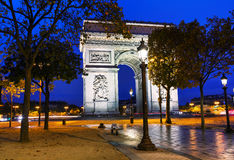 The Triumphal Arch Arc de Triomphe in Paris, France. At night Stock Image