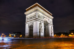 The Triumphal Arch Arc de Triomphe in Paris, France. At night Royalty Free Stock Image