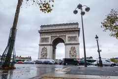 Triumphal arch. Arc de triomphe. View of Place Charles de Gaulle. Famous touristic architecture landmark in rainy day. Long exposure photography. Paris. France Stock Images