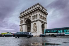Triumphal arch. Arc de triomphe. View of Place Charles de Gaulle. Famous touristic architecture landmark in rainy day. Long exposure photography. Paris. France Stock Photography