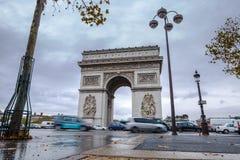 Triumphal arch. Arc de triomphe. View of Place Charles de Gaulle. Famous touristic architecture landmark in rainy day. Long exposure photography. Paris. France Stock Photos