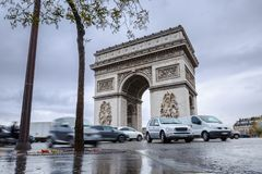 Triumphal arch. Arc de triomphe. View of Place Charles de Gaulle. Famous touristic architecture landmark in rainy day. Long exposure photography. Paris. France Stock Photo