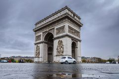 Triumphal arch. Arc de triomphe. View of Place Charles de Gaulle. Famous touristic architecture landmark in rainy day. Long exposure photography. Paris. France Royalty Free Stock Image