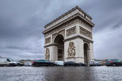 Triumphal arch. Arc de triomphe. View of Place Charles de Gaulle. Famous touristic architecture landmark in rainy day. Long exposure photography. Paris. France Royalty Free Stock Photo
