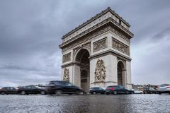 Triumphal arch. Arc de triomphe. View of Place Charles de Gaulle. Famous touristic architecture landmark in rainy day. Long exposure photography. Paris. France Royalty Free Stock Photography