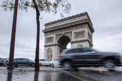 Triumphal arch. Arc de triomphe. View of Place Charles de Gaulle. Famous touristic architecture landmark in rainy day. Long exposure photography. Paris. France Stock Photos
