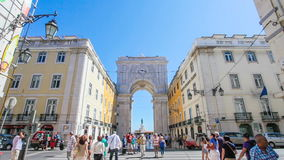 Triumphal Arch of Augusta street in Lisbon. Lisbon, Portugal. August  31, 2014: the monumental Triumphal Arch that connects the Augusta street with the Praca do stock footage