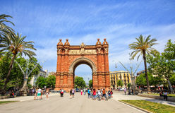 Triumphal arch in Barcelona. Barcelona, Spain - May 27, 2016: many tourists near the Arc de Triomphe in sunny summer day Royalty Free Stock Photos