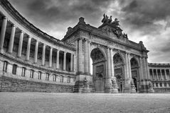 Triumphal Arch in Brussels. Dramatic black and white HDR image of The Triumphal Arch (Arc de Triomphe) in the Cinquantenaire park in Brussels, Belgium. Built in Stock Image