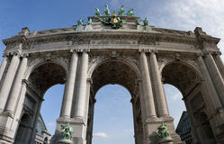 The Triumphal Arch in Brussels. The Triumphal Arch (Arc de Triomphe) in the Cinquantenaire park in Brussels. Built in 1880 for the 50th anniversary of Belgium Royalty Free Stock Photos