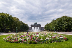 The Triumphal Arch in Brussels, Belgium. The Triumphal Arch in Cinquantenaire Parc in Brussels, Belgium with flowers in summer Stock Image