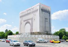 Triumphal Arch in Bucharest, Romania. Bucharest, Romania - June 24, 2015: The Triumphal Arch in Bucharest is under major renovation Stock Image
