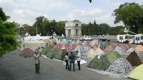 Triumphal Arch in the center of Chisinau, Moldova with protesters camp stock footage