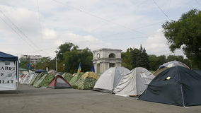 Triumphal Arch in the center of Chisinau, Moldova with protesters camp. CHISINAU, MOLDOVA - SEP 2015 Protesters camp outside government of Moldova in the Main stock footage