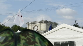 Triumphal Arch in the center of Chisinau, Moldova with protesters camp stock video footage