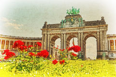 Triumphal Arch in Cinquantenaire Park in Brussels, Belgium. Photo of Triumphal Arch in Cinquantenaire Park in Brussels, Belgium styled as vintage Stock Photos