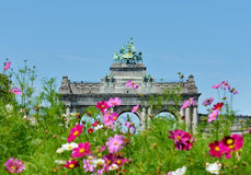 Triumphal Arch in Cinquantenaire Park in Brussels. With cosmos flowers Royalty Free Stock Photography