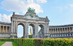 Triumphal Arch in Cinquantenaire Park in Brussels. With flag of Belgium Stock Photos