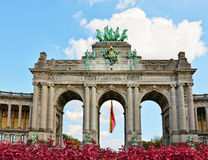 Triumphal Arch in Cinquantenaire Park in Brussels. With flowers. Belgium Stock Image