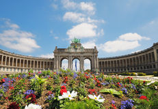Triumphal Arch in Cinquantennaire Park. In Brussels in summer with flowers on front of it Royalty Free Stock Image