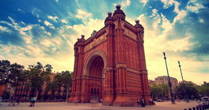 Triumphal arch. Clouds sky over Barcelona triumphal arc. Barcelona landmarks. Barcelona city square. Brick triumphal arch in Barcelona city. Travel destination stock video footage
