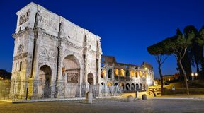 Triumphal Arch and the Colosseum. Beautiful night image of the eternal city, Rome Stock Photos