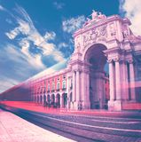 Triumphal Arch in Commerce Square at sunset with sun and clouds stock photos