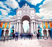 Triumphal Arch in Commerce Square at sunset with sun and clouds royalty free stock image
