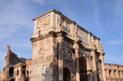 Triumphal Arch of Constantine and Colosseum in Rome against blue sky, Italy Royalty Free Stock Photo