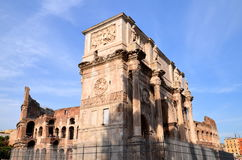 Triumphal Arch of Constantine and Colosseum in Rome against blue sky, Italy Royalty Free Stock Photography