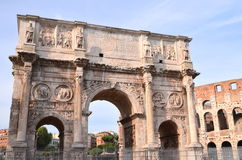 Triumphal Arch of Constantine and Colosseum in Rome against blue sky, Italy Royalty Free Stock Photos