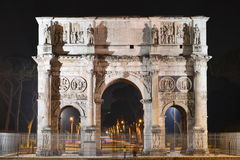 Triumphal Arch of Constantine nearby Colosseum in Rome against blue sky, Italy. Triumphal Arch of Constantine nearby Colosseum in Rome against blue sky in Italy Royalty Free Stock Photography