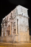 Triumphal Arch of Constantine nearby Colosseum in Rome against blue sky, Italy Stock Photography