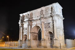 Triumphal Arch of Constantine nearby Colosseum in Rome against blue sky, Italy Royalty Free Stock Photography