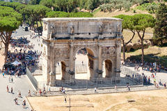The triumphal Arch of Constantine next to the  Colosseum in Rome. The triumphal Arch of Constantine next to the ruins of the Colosseum in Rome Stock Image