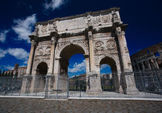Triumphal arch of Constantine in Rome. Triumphal arch of Constantine and coliseum in background at Rome, Italy Royalty Free Stock Photos