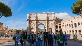 Triumphal Arch of Constantine in Rome front of Colosseum, Most famous places in Time Lapse. Triumphal Arch in Rome Colosseum in Background, Time lapse of most stock footage